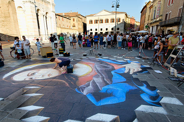 Ferrara Busker Festival 2016, Italy Ferrara, Italy - August 27, 2016: Buskers Festival 2015 in Ferrara, Emilia Romagna, Italy. Busker Festival is a popular event with street artists which is held annually in the historic center of Ferrara artistical stock pictures, royalty-free photos & images