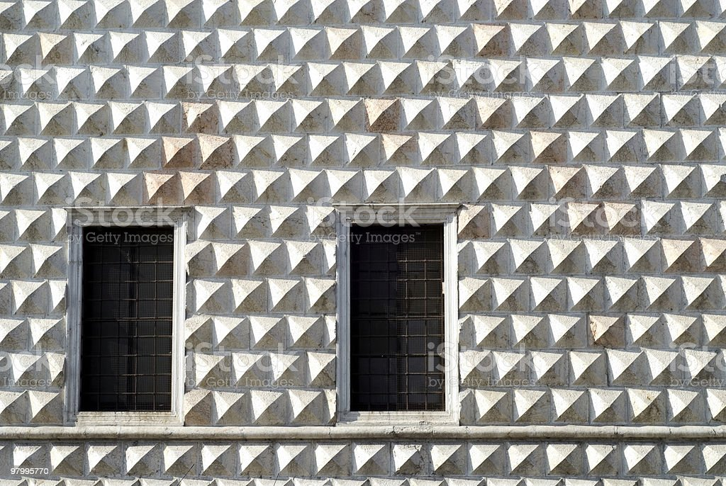Ferrara (Italy), wall of an ancient palace with two windows royalty-free stock photo