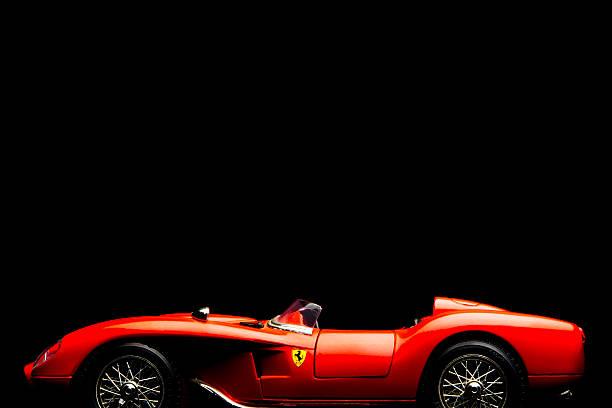 Ferrari 250 Testarossa model car Kampen, The Netherlands - July 30, 2013: Studio shot of a red Ferrari 250 Testarossa BBurago model car on a black background. The Ferrari 250 Testarossa is a V12 race car produced in the 1950s and 1960s. ferrari stock pictures, royalty-free photos & images