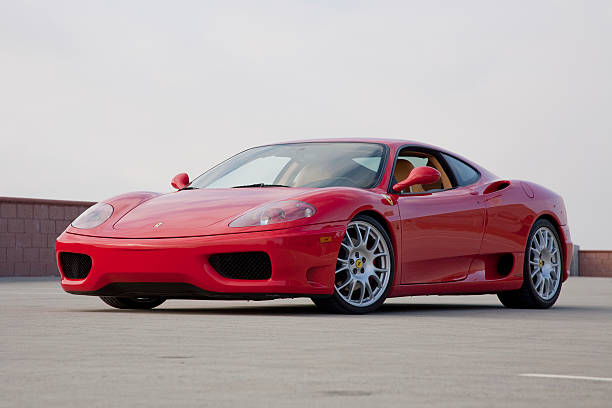 Ferrari 360 Modena CERRITOS, CA, USA - MARCH 14 2009: A red Ferrari 360 Modena sports car in Cerritos, CA. The 360 boasts a top speed of 186 mph due to the powerful 3.6L V8 engine. ferrari stock pictures, royalty-free photos & images