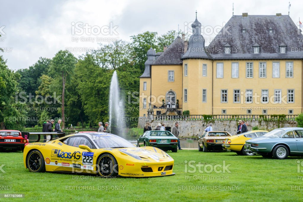 Ferrari 458 Challenge EVO race car with classic Ferrari sports cars....