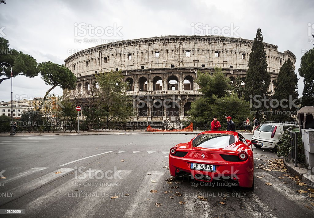 Ferrari 458 Italia and Coliseum, in Rome royalty-free stock photo