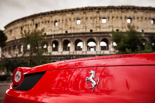 Ferrari 458 Italia and Coliseum, in Rome Rome, Italy - December 16, 2012: Details of a red Ferrari 458 Italia parked just in front of the Coliseum in Rome ferrari stock pictures, royalty-free photos & images