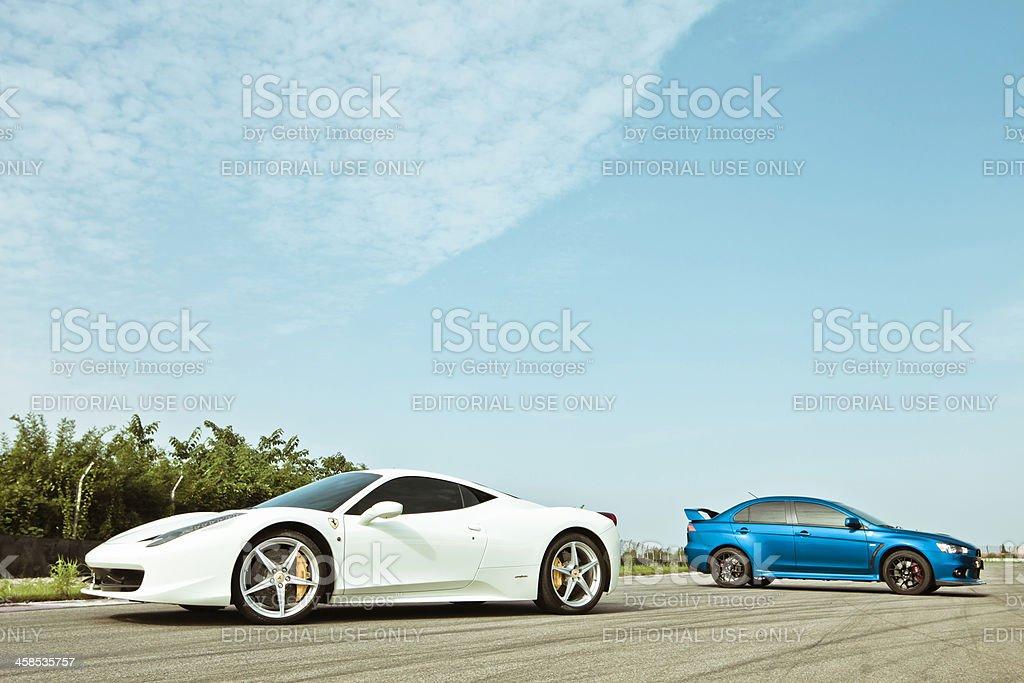 Ferrari 458 Italia and Mitsubishi Lancer Evolution X stock photo