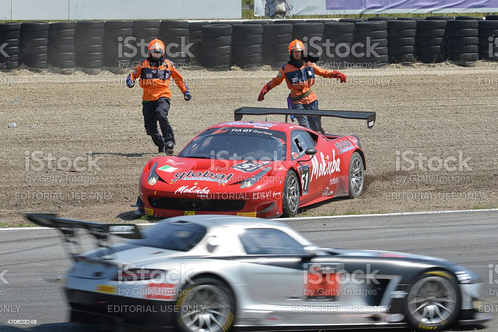 Ferrari 458 Italia crash recovery during a race stock photo