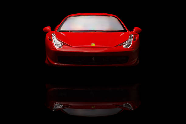 ferrari 458 Italia Krivoy Rog, Ukraine - August 22, 2014: Toy ferrari 458 Italia on black backgrond. The photo is made in a studio. Editorial Use Only. ferrari stock pictures, royalty-free photos & images