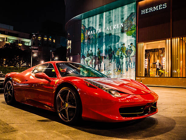 Ferrari car Bangkok Thailand Bangkok, Thailand - February 21, 2016: Red Ferrari car in front of Central Embassy a luxury mall with very expensive brands like Hermes and Ralph Lauren ferrari stock pictures, royalty-free photos & images