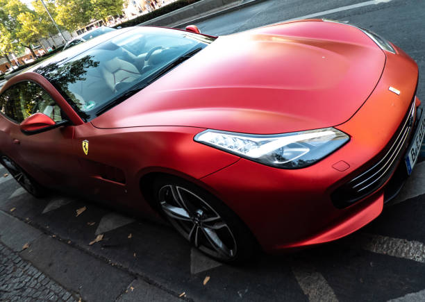 Ferrari car Berlin, Germany - September 19, 2018: Ferrari GTC4Lusso, a powerful and sporty car by Ferrari SpA, the Italian sports car manufacturer based in Maranello and founded by Enzo Ferrari status symbol stock pictures, royalty-free photos & images
