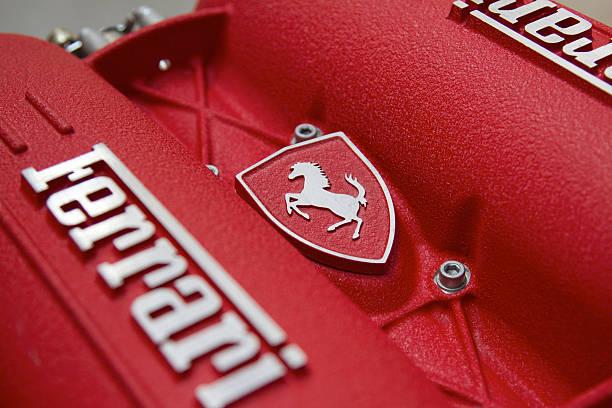 "Ferrari Engine block ""Melbourne, Australia - December 15, 2011. Famous Ferrari pranching horse logo on an engine block of a Ferrari F430. The F430 has a 4.3L 490HP V8 engine."" ferrari stock pictures, royalty-free photos & images"