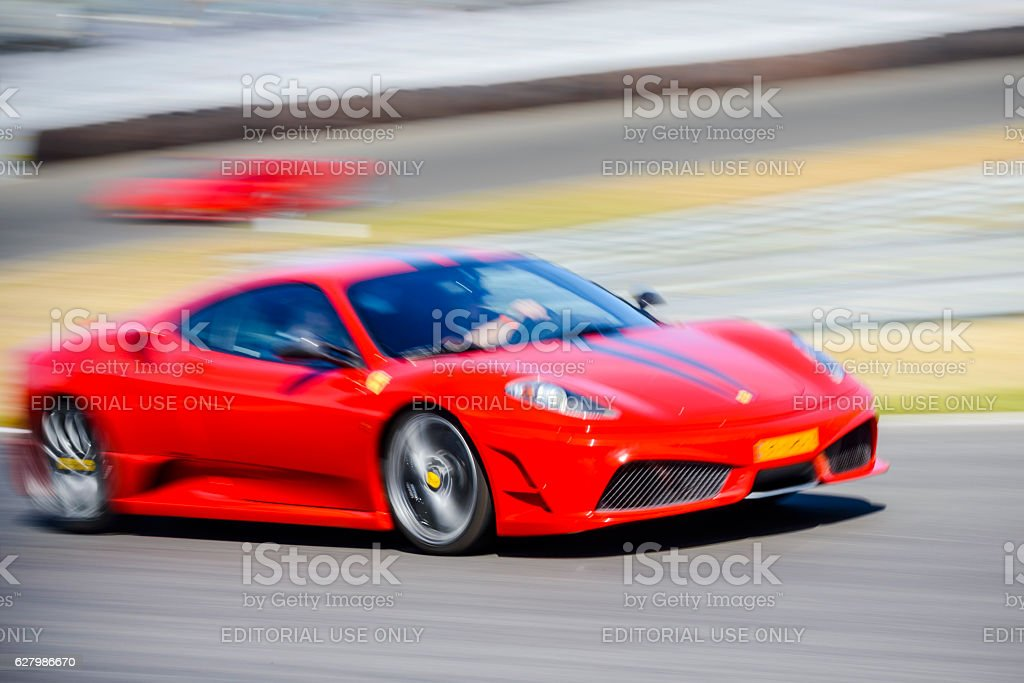 Ferrari F430 Scuderia Italian V8 sports car driving fast stock photo