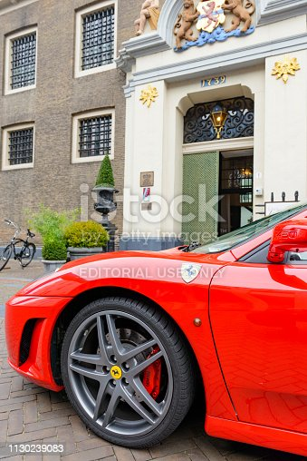 Entrance of the three Michelin star restaurant Liberije in the city of Zwolle, The Netherlands. A red Ferrari F430 Spider convertible sports car is parked in front of the entrance.