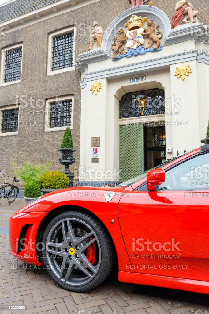 Ferrari F430 Spider convertible sports car is parked in front of Liberije Restaurant in Zwolle stock photo