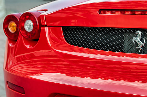 Ferrari F430's rear Budapest, Hungary - September 19th, 2015: The grill, left rear lamps and the emblem on the backside of a Ferrari F430 luxury sport car. ferrari stock pictures, royalty-free photos & images