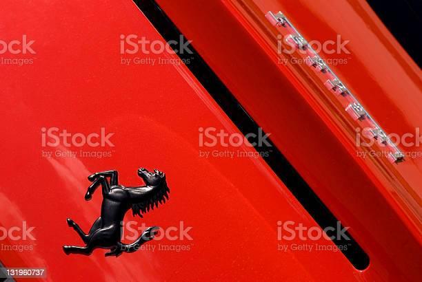Ferrari horse logo close up on red car background picture id131960737?b=1&k=6&m=131960737&s=612x612&h=b4hvs2xw3ob ahupfleck xwdjhuacuefowlaogn2nu=