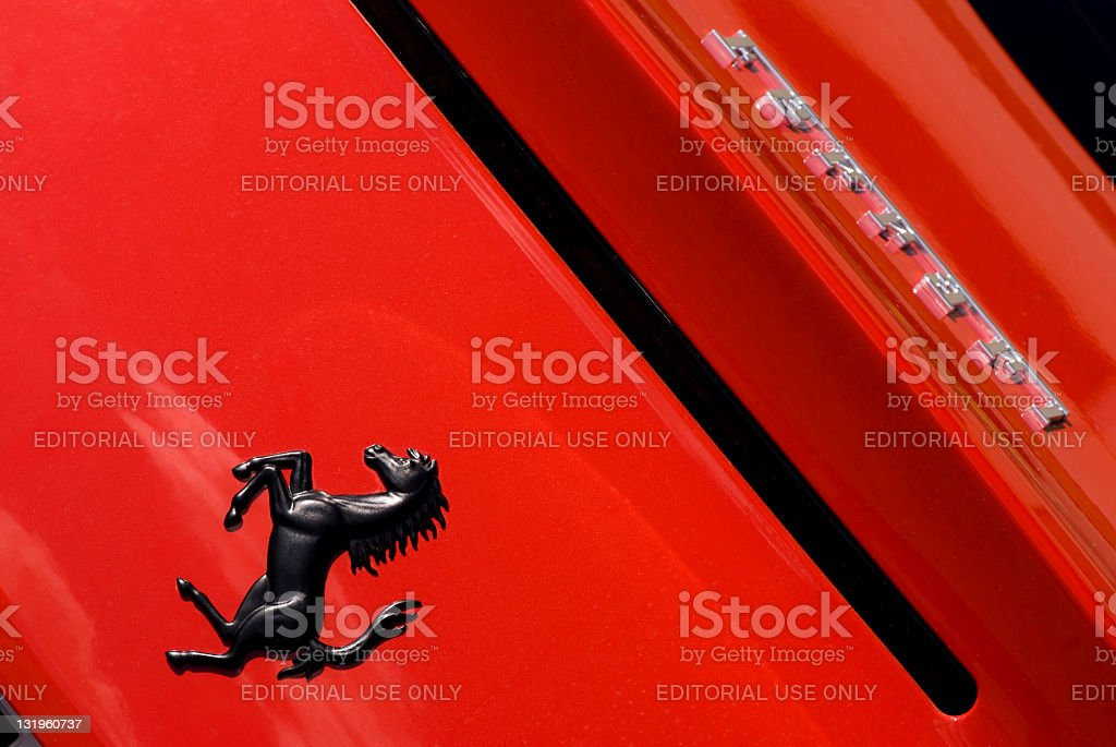 Ferrari Horse Logo Close Up on Red Car Background stock photo