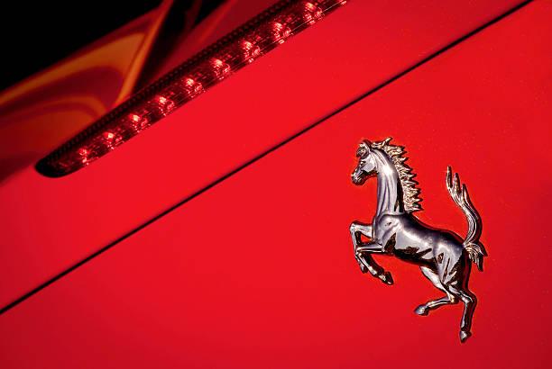 "Ferrari Horse Logo Macro on Red Background ""Mugello, Italy - February 19, 2011: Ferrari Car Industry Famous Horse Logo on the back of a Ferrari 458 Italia Sport Car"" ferrari stock pictures, royalty-free photos & images"