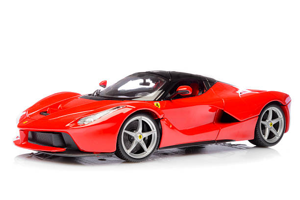 Ferrari LaFerrari hybrid sports car model car Kampen, The Netherlands - October 18, 2015: Red Ferrari LaFerrari hybrid sports car model car by Bburago isolated on a white background with a reflection in the foreground. The Ferrari LaFerrari, also known as Ferrari F150 is a hybrid supercar with a V12 engine and a KERS unit for extra power. ferrari stock pictures, royalty-free photos & images