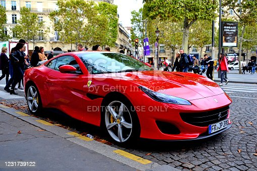 Paris, France - October 24th 2019 : red Ferrari Portofino parked on the Champs Elysees. This model is one of the last of Ferrari, and is producted since 2017.