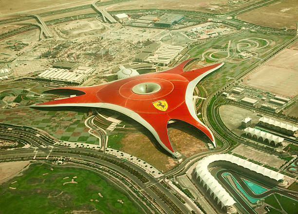 """Ferrari World Park """"ABU DHABI, UAE -  APRIL 07 2012: Ferrari World Park is the largest indoor amusement park in the world. The roof has a total surface area of 200,000 m2.  Abu Dhabi on April 07, 2012. Bird's eye view"""" ferrari stock pictures, royalty-free photos & images"""