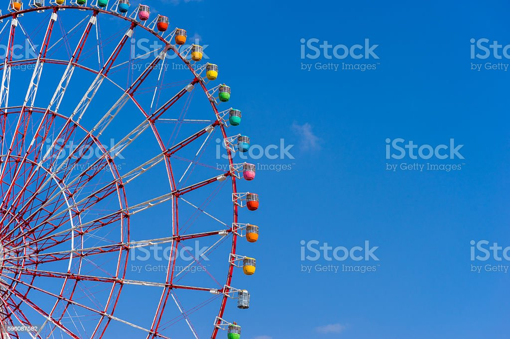 Ferris wheel against blue sky background royalty-free stock photo