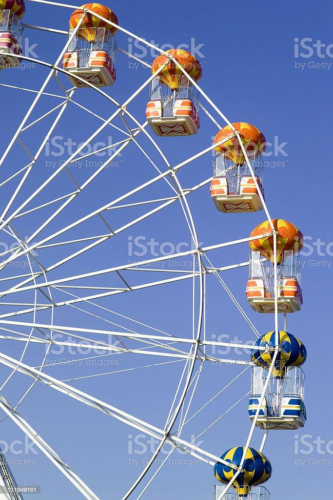 Ferris wheel against clear blue sky royalty-free stock photo