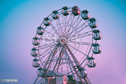 Ferris wheel against the background of the summer sky in the daytime