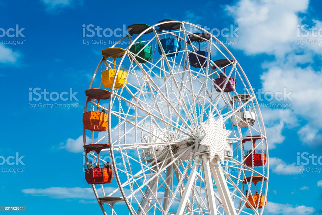 Ferris Wheel and and cloudy sky at mount Tibidabo in Barcelona, Spain stock photo