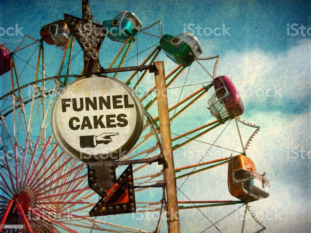 ferris wheel and funnel cakes sign stock photo
