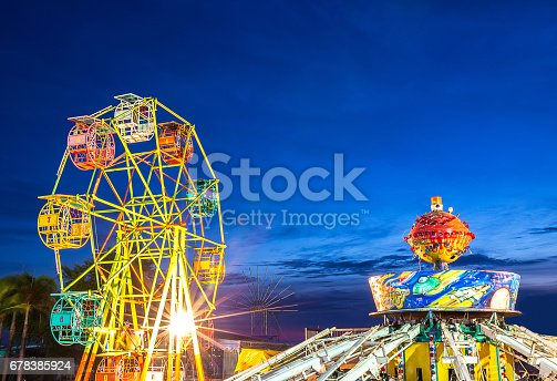 istock ferris wheel and gravity maching in movable amusement park 678385924