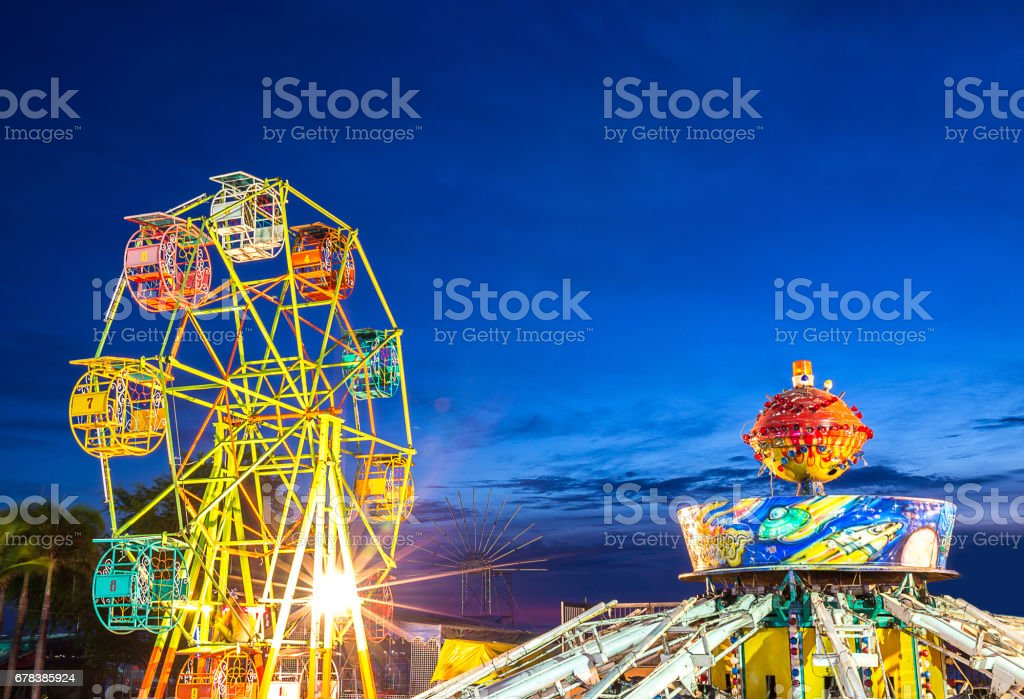 ferris wheel and gravity maching in movable amusement park stock photo