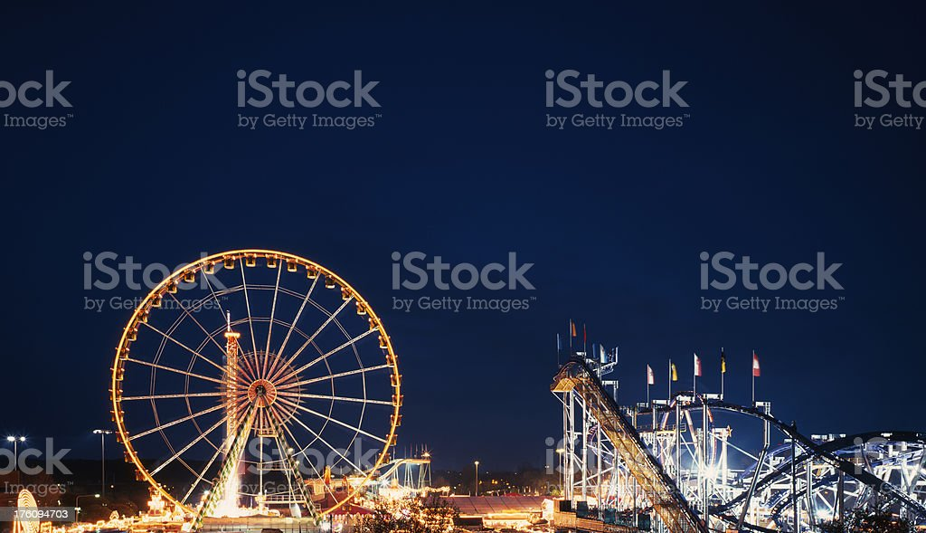 Ferris wheel and roller coaster, Dippemess, Frankfurt, Germany royalty-free stock photo