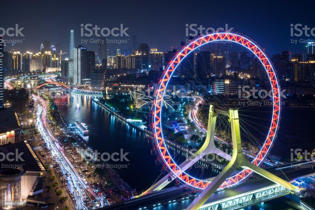 Ferris Wheel and Tianjin Skyline at Night stock photo