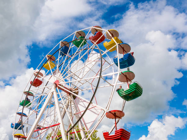 Ferris wheel at funfair or travelling carnival in Dokkum, Friesland, Netherlands Ferris wheel at funfair or travelling carnival during Admiralty Days in Dokkum, Friesland, Netherlands ferris wheel stock pictures, royalty-free photos & images