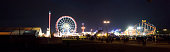 Munich, Germany - September 20, 2015: ferris wheel at Oktoberfest amusement park in Munich. The Oktoberfest is the largest fair in the world and is held annually in Munich.