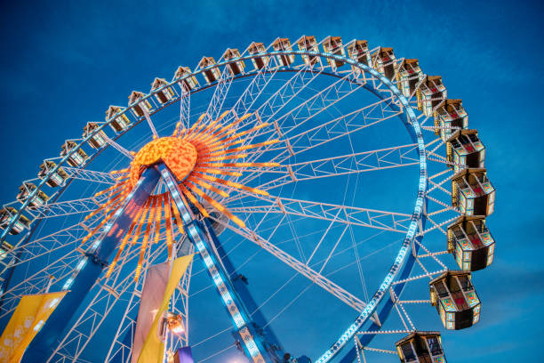 Ferris Wheel at the Oktoberfest in Munich, Germany Ferris Wheel at the Oktoberfest in Munich, Germany ferris wheel stock pictures, royalty-free photos & images