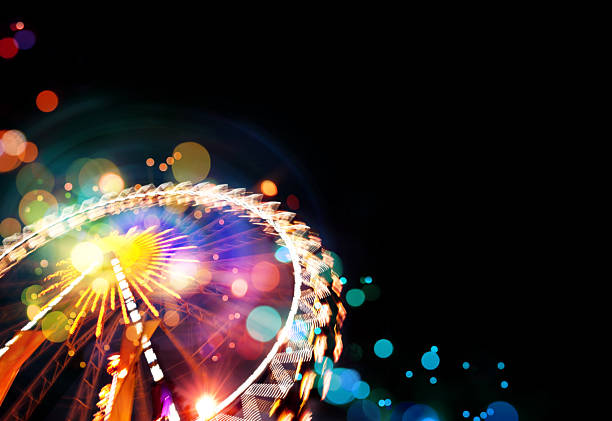 ferris wheel background with bokeh effects - carnival stock photos and pictures
