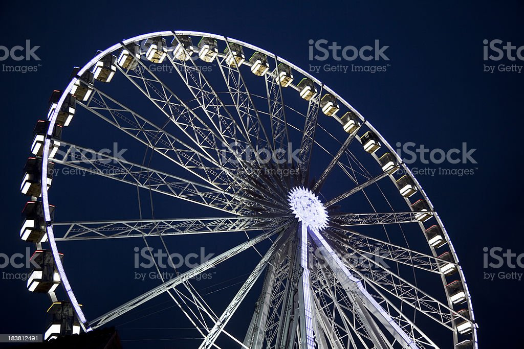 Ferris wheel illuminated at night royalty-free stock photo