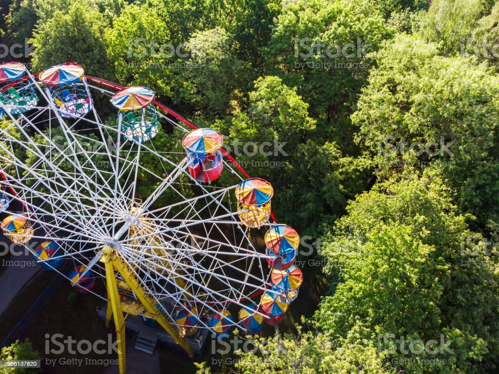 ferris wheel in amusement park at summer morning - Royalty-free Aerial View Stock Photo