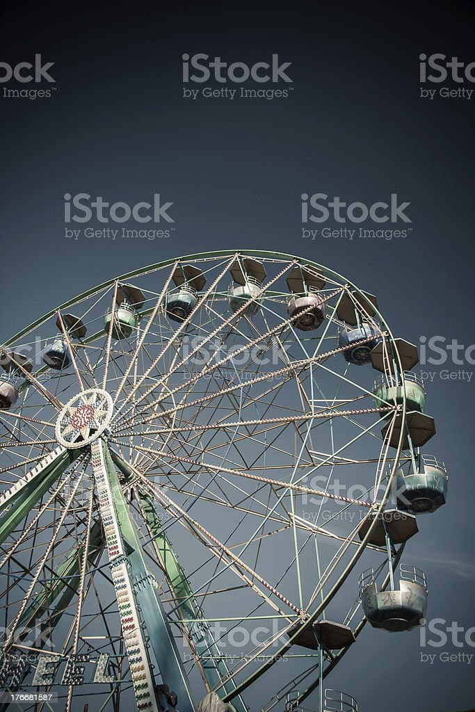 Ferris Wheel in Amusement Park on Clear Blue Sky royalty-free stock photo