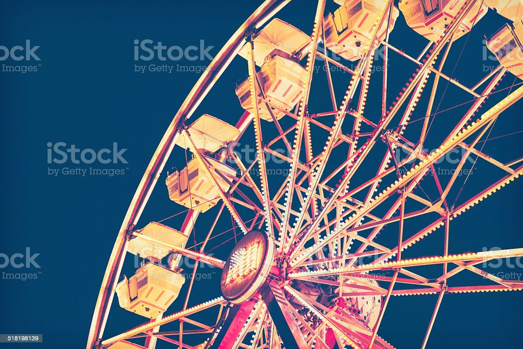 Ferris Wheel In Retro Tones Against Night Sky stock photo