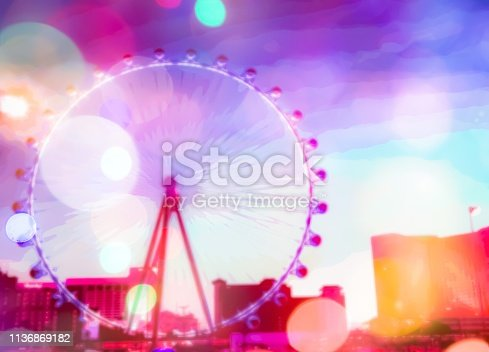 ferris wheel in the city at Las Vegas, USA with the night light bokeh