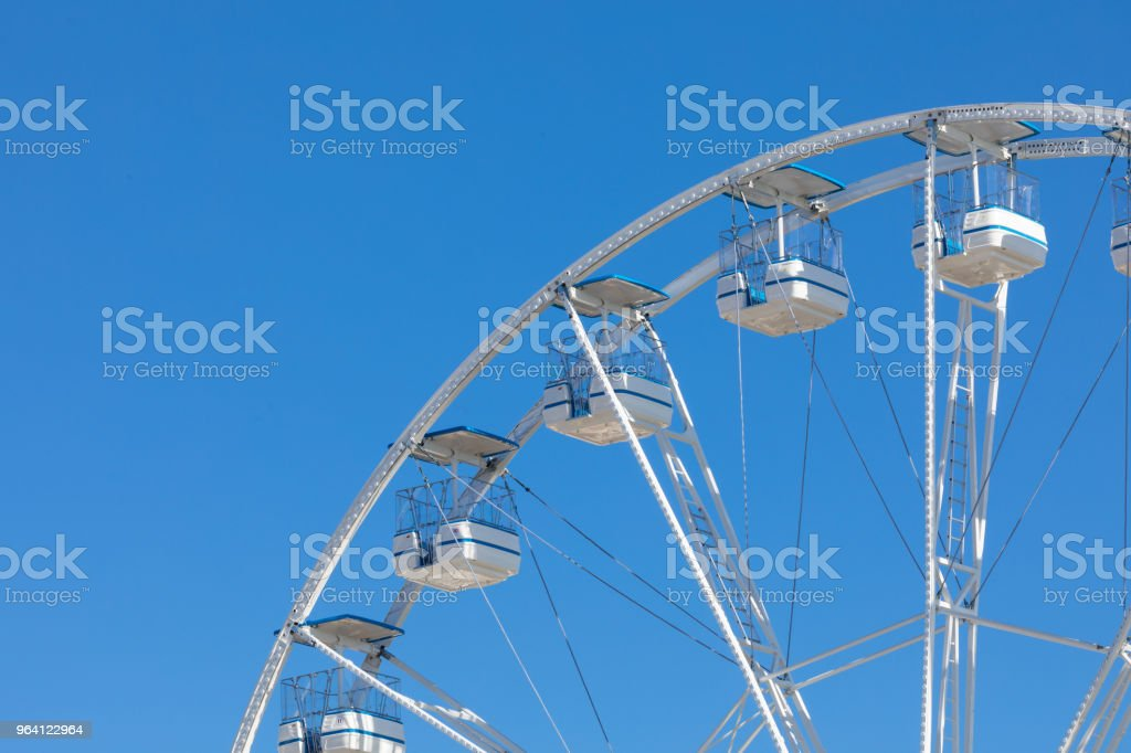 Ferris wheel municipal park with blue clear sky on the background stock photo