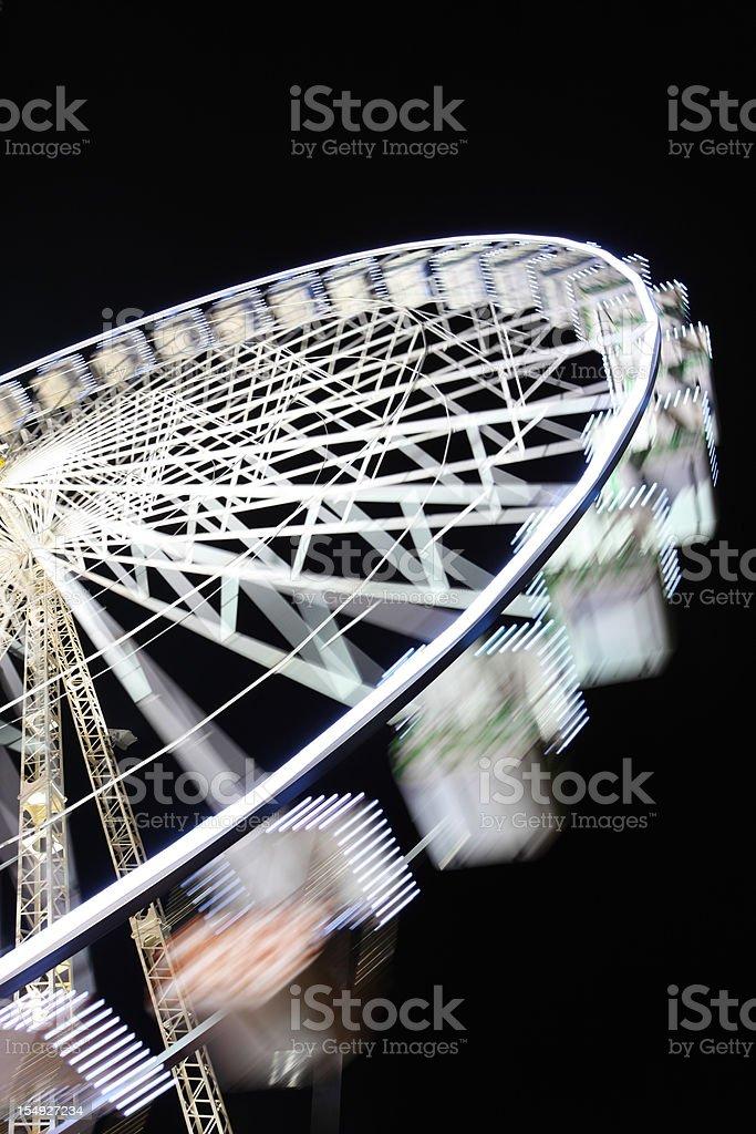 Ferris wheel, night time, side view royalty-free stock photo