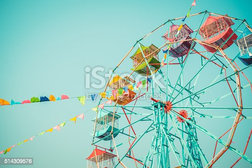 Ferris wheel on blue sky background vintage color