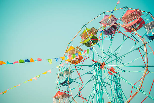 Ferris wheel on blue sky background vintage color Ferris wheel on blue sky background vintage color ferris wheel stock pictures, royalty-free photos & images