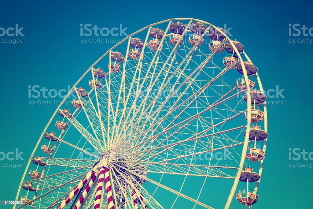ferris wheel on blue sky stock photo