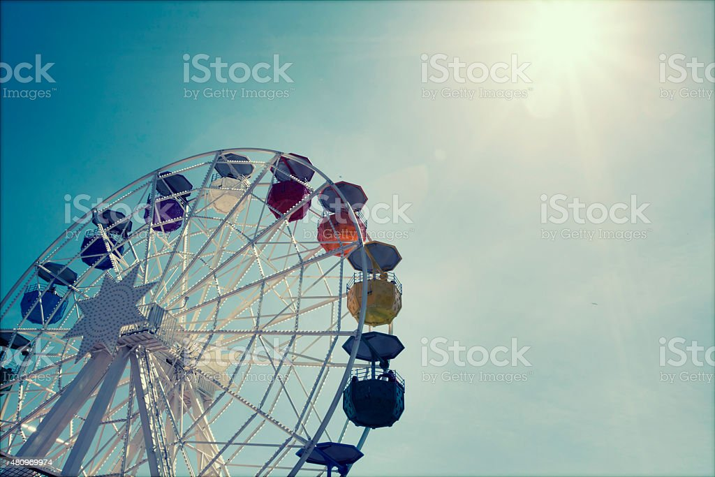 Ferris wheel over blue sky stock photo