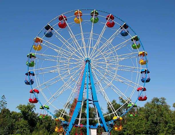 Ferris Wheel A colourful ferris wheel. Front view ferris wheel stock pictures, royalty-free photos & images