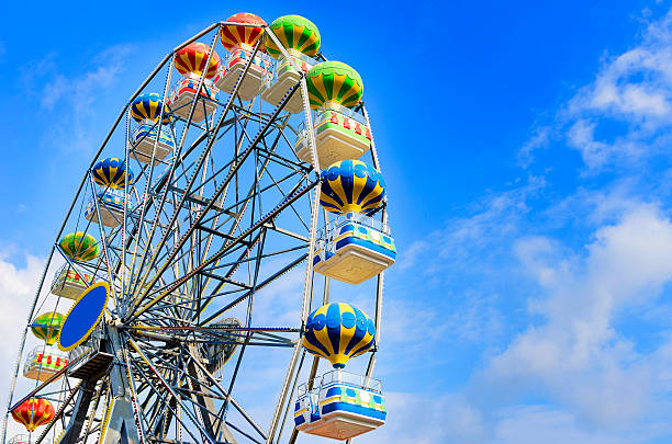Ferris Wheel Ferris wheel on the background of blue sky with cloud amusement park stock pictures, royalty-free photos & images