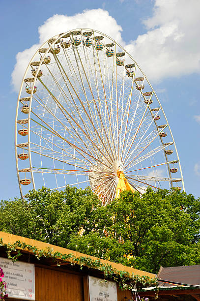 ferris wheel - Riesenrad bei der Bergkirchweih ferris wheel in front of blue sky in erlangen bergkirchweih erlangen stock pictures, royalty-free photos & images
